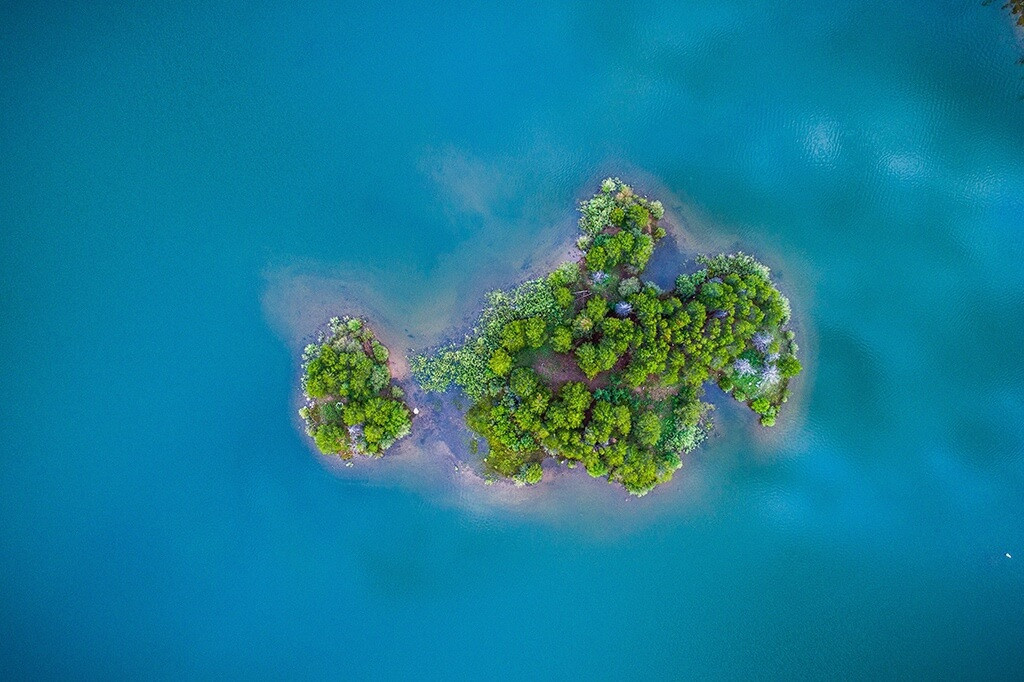 Drone picture of a small, green island